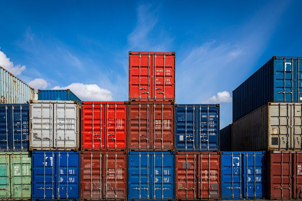 Storage containers stacked on top of each other beneath a blue sky.