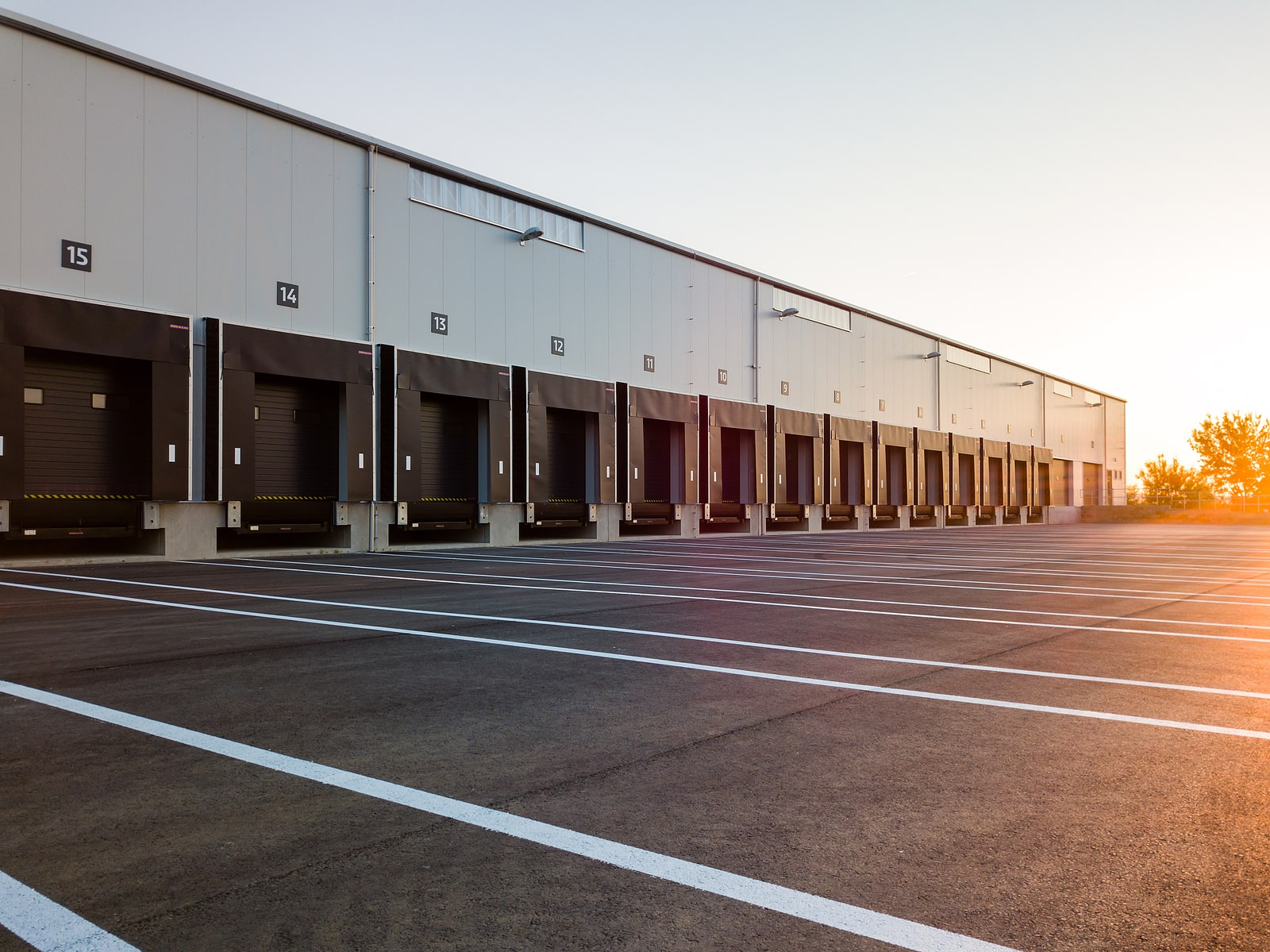 Outside of a warehouse with loading docks for storage trailers